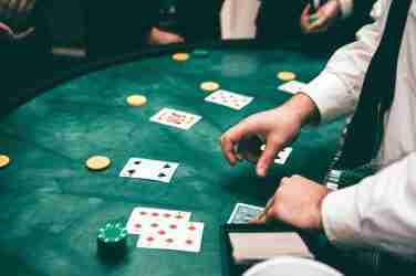 Croupier Dealing Cards In Casino